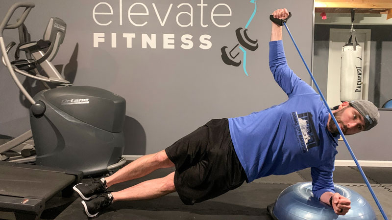 Side Plank on a Bosu Ball with a Reverse Fly